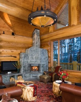 Choosing and hanging the right chandelier at chandeliers make a welcome addition to a cabin they warm up a cozy kitchen and they do a good job of lighting up a roomy log living area mozeypictures Gallery